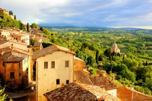 View over the Tuscan countryside and the town of Montepulciano at sunset