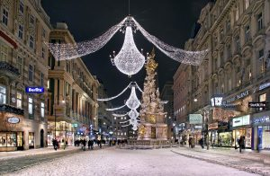 Lights line the snowy streets of Vienna
