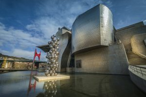 The exterior of the Guggenheim Museum, with artwork 'Tall Tree & The Eye'