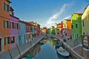 Canals lined in colourful houses in Burano, Venice