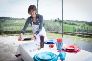 Barbara sets the table in her home in Siena, Tuscany