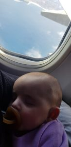 Eliana sleeping on her plane ride at 5 months